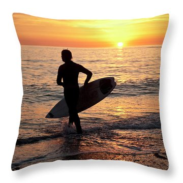 A Young Man Surfing At Sunset Off Aberystwyth Beach, Wales Uk Throw Pillow