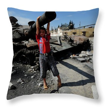 A Young Syrian Boy Plays On The Turret Throw Pillow by Andrew Chittock