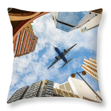 Airplane Above City Throw Pillow
