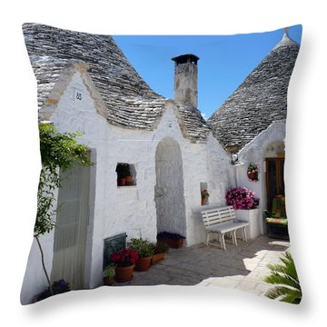 Alberobello Courtyard With Trulli Throw Pillow