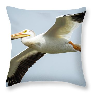 Throw Pillow featuring the photograph  American White Pelican Flyby  by Ricky L Jones