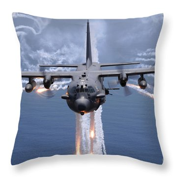 Throw Pillow featuring the photograph An Ac-130h Gunship Aircraft Jettisons by Stocktrek Images