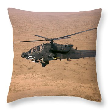 An Ah-64d Apache Longbow Fires A Hydra Throw Pillow by Terry Moore
