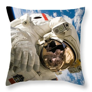 An Astronaut Mission Specialist Throw Pillow by Stocktrek Images
