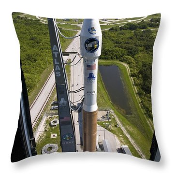 An Atlas V Rocket On The Launch Pad Throw Pillow by Stocktrek Images