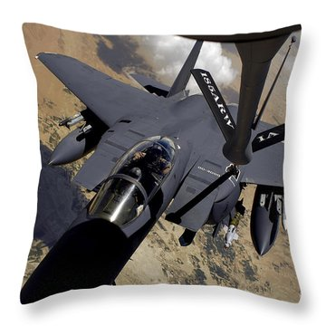 An F-15 Strike Eagle Prepares Throw Pillow by Stocktrek Images