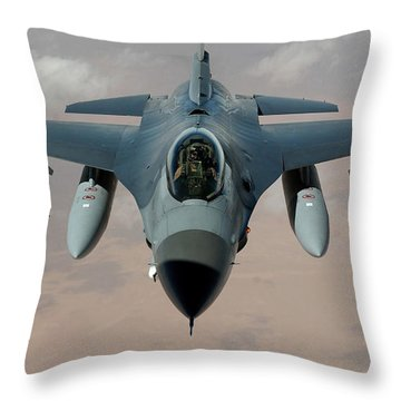 An F-16 Fighting Falcon Flies A Mission Throw Pillow by Stocktrek Images