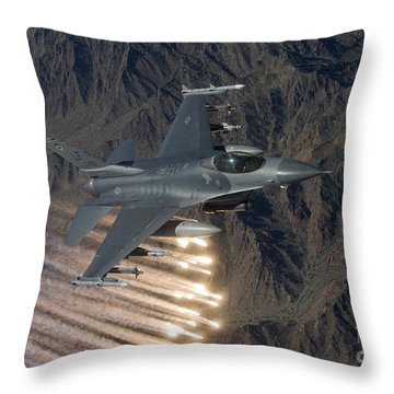 An F-16 Fighting Falcon Releases Flares Throw Pillow by HIGH-G Productions