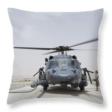 An Hh-60 Pave Hawk Lands After A Flight Throw Pillow by Stocktrek Images
