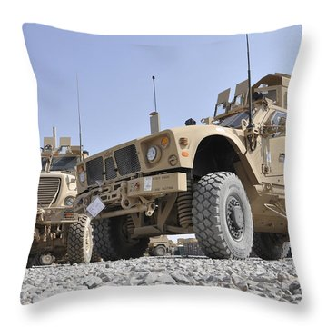 An M-atv Mine Resistant Ambush Throw Pillow by Stocktrek Images