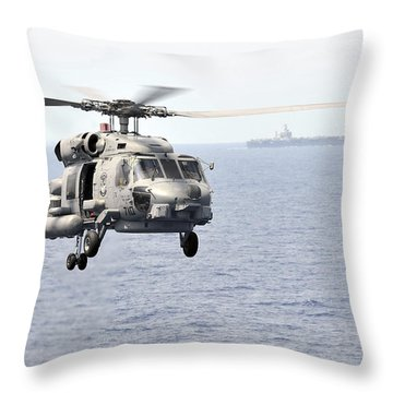An Mh-60r Seahawk Helicopter In Flight Throw Pillow by Stocktrek Images