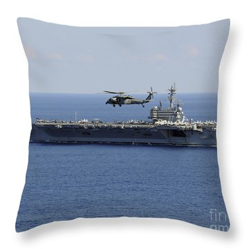 An Mh-60s Seahawk Helicopter Flies Throw Pillow by Stocktrek Images