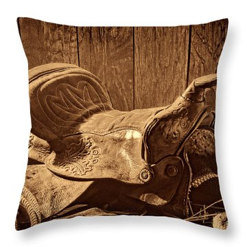 An Old Saddle Throw Pillow by American West Legend By Olivier Le Queinec