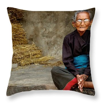 An Old Woman In Bhaktapur Throw Pillow by Valerie Rosen