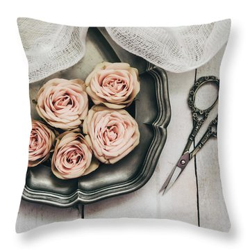 Throw Pillow featuring the photograph Antiqued Roses by Kim Hojnacki