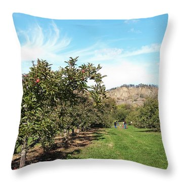 Throw Pillow featuring the photograph Apple Picking by Jose Rojas