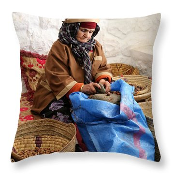 Throw Pillow featuring the photograph Argan Oil 3 by Andrew Fare