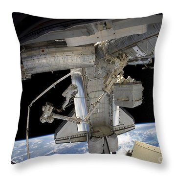 Astronaut Participates In A Spacewalk Throw Pillow by Stocktrek Images