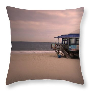 Throw Pillow featuring the photograph At The Beach by Desline Vitto