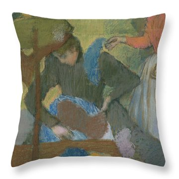 At The Hat Maker Throw Pillow by Edgar Degas
