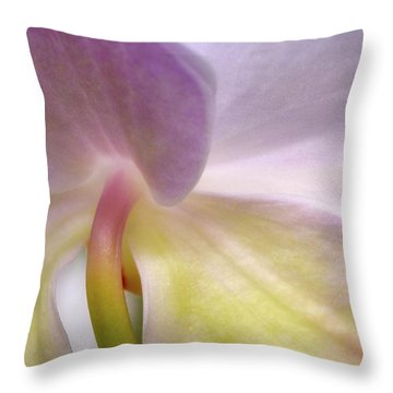 Throw Pillow featuring the photograph Backlit Orchid by Michael Hubley