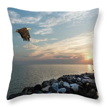 Bald Eagle Flying Over A Jetty At Sunset Throw Pillow