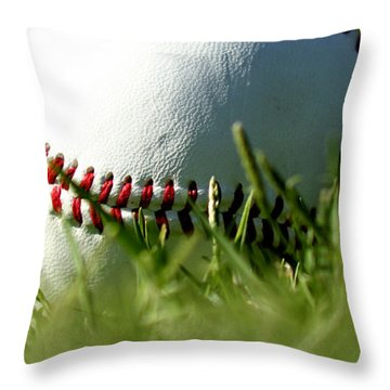 Baseball In Grass Throw Pillow by Chris Brannen