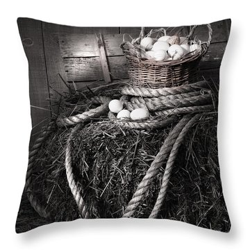 Basket Of Eggs On A Bale Of Hay Throw Pillow by Sandra Cunningham