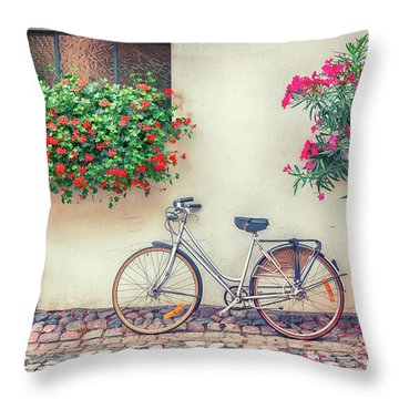 Throw Pillow featuring the photograph bike in France village  by Ariadna De Raadt