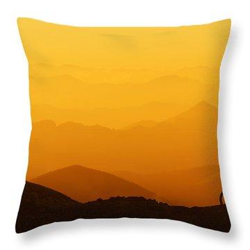 Biker Riding On Mountain Silhouettes Background Throw Pillow