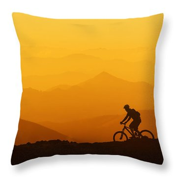 Biker Riding On Mountain Silhouettes Background Throw Pillow