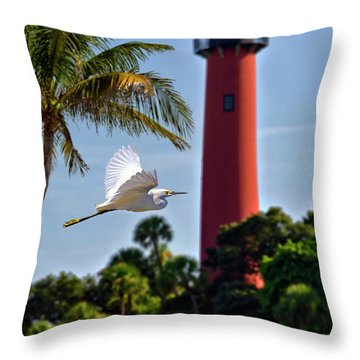 Bird In Flight Under Jupiter Lighthouse, Florida Throw Pillow by Justin Kelefas