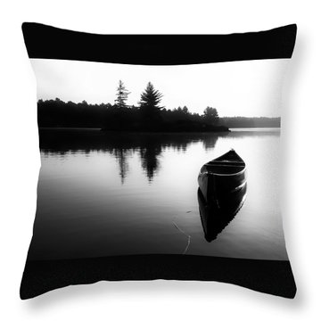 Black And White Canoe In Still Water Throw Pillow