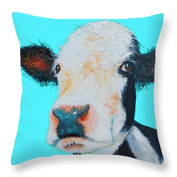 Black And White Cow On Blue Background Throw Pillow by Jan Matson