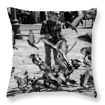 Black And White Of Boy Feeding Pigeons In Sarajevo, Bosnia And Herzegovina  Throw Pillow