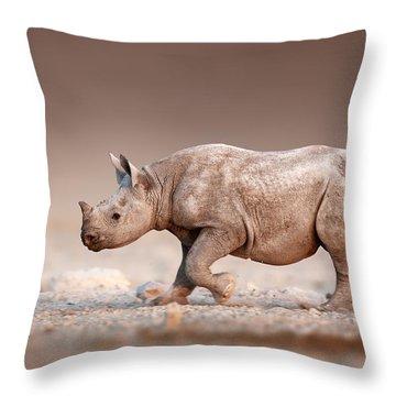 Black Rhinoceros Baby Running Throw Pillow