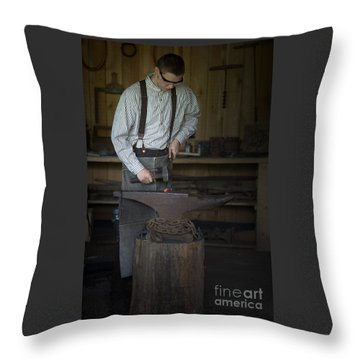 Blacksmith At Work Throw Pillow by Liane Wright