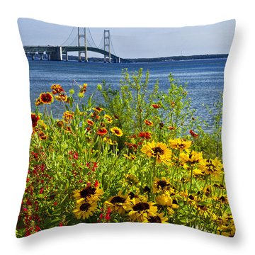 Blooming Flowers By The Bridge At The Straits Of Mackinac Throw Pillow