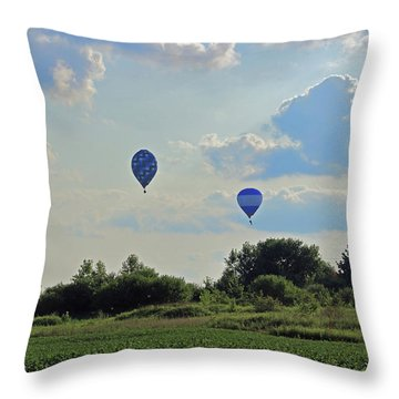 Throw Pillow featuring the photograph Blue Balloons Over A Field by Angela Murdock