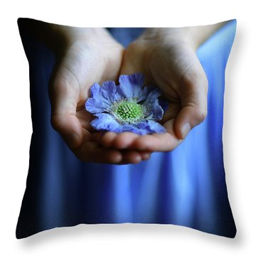 Blue Flower In Little Girl's Hands Throw Pillow