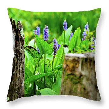 Throw Pillow featuring the photograph Blue Flowers And Artistic Logs by Dennis Dame