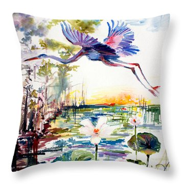 Throw Pillow featuring the painting Blue Heron Glides Over Lotus Flowers by Ginette Callaway
