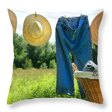 Blue Jeans And Straw Hats On Clothesline Throw Pillow by Sandra Cunningham