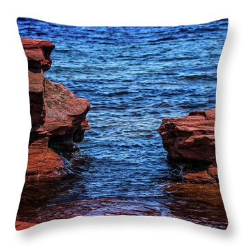Throw Pillow featuring the photograph Blue Water Between Red Stone by Chris Bordeleau