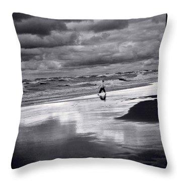 Boy On Shoreline Throw Pillow by Steve Gadomski