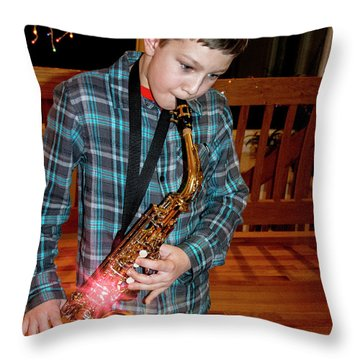 Boy Playing The Saxophone Throw Pillow