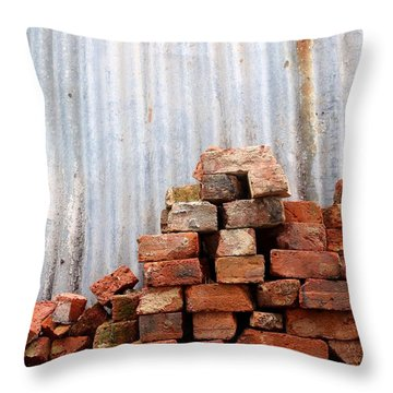 Throw Pillow featuring the photograph Brick Piled by Stephen Mitchell
