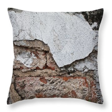 Throw Pillow featuring the photograph Broken White Stucco Wall With Weathered Brick Texture by Jason Rosette