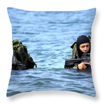 Buds Students Wade Ashore During An Throw Pillow by Stocktrek Images