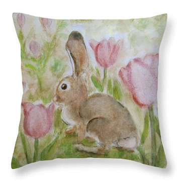 Bunny In The Tulips Throw Pillow by Laurie Morgan